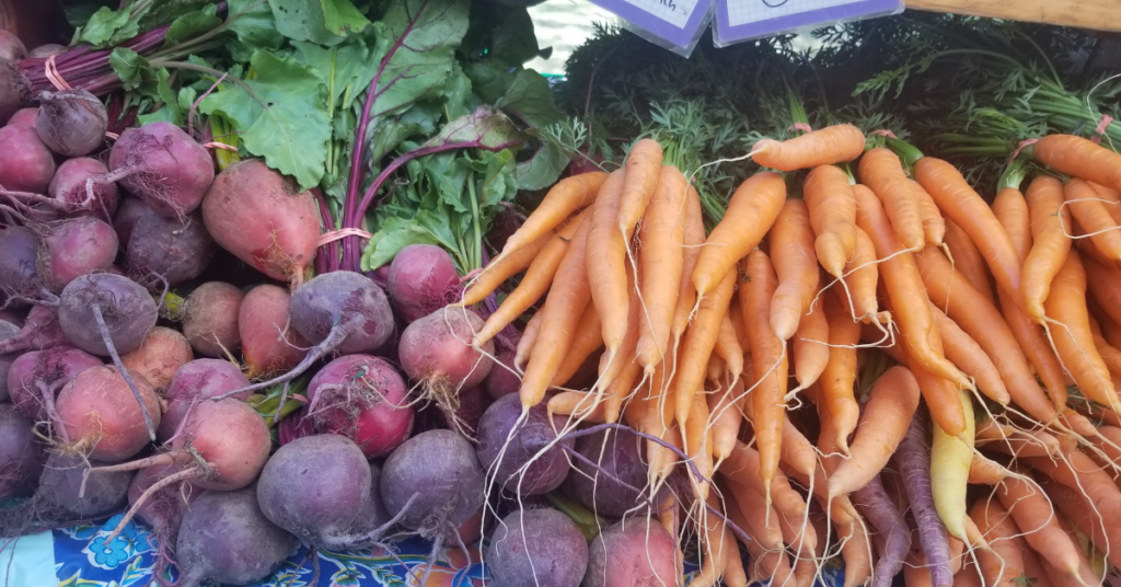 Beets and Carrots at a Farmers Market