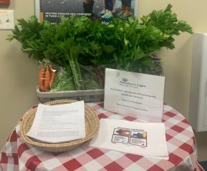 Table with produce and flyers at healthcare facility